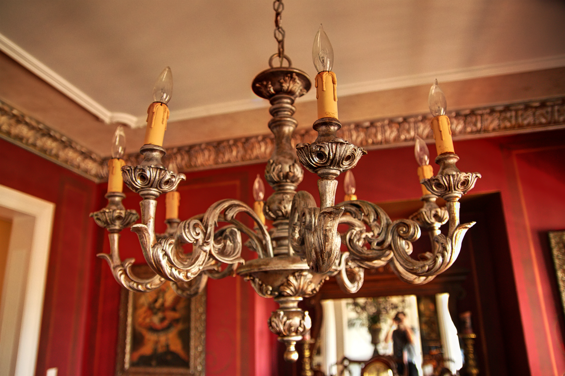 Chandelier design change finished:  from its previous garish gold to this beautiful gilt and antique silver look.