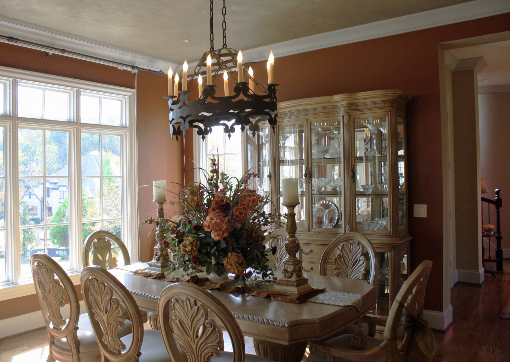 Beautiful wall color and shimmering accented ceiling complete this dining rooms design.