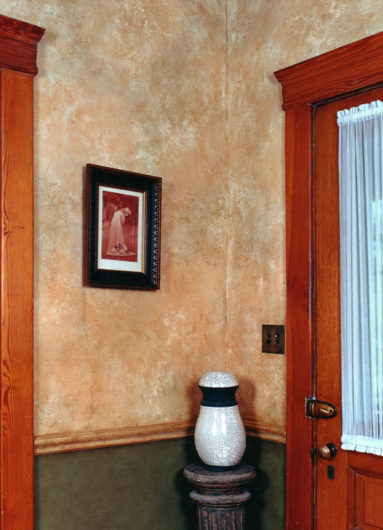 Faux stone wall finish up and green and bronze glaze below.