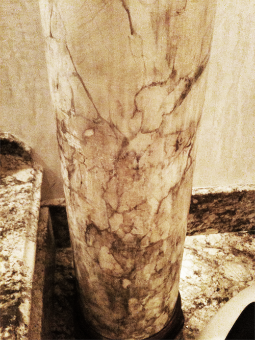 Faux marble column with bronze capital and base – designed and finished to match this customer's existing real marble surfaces.