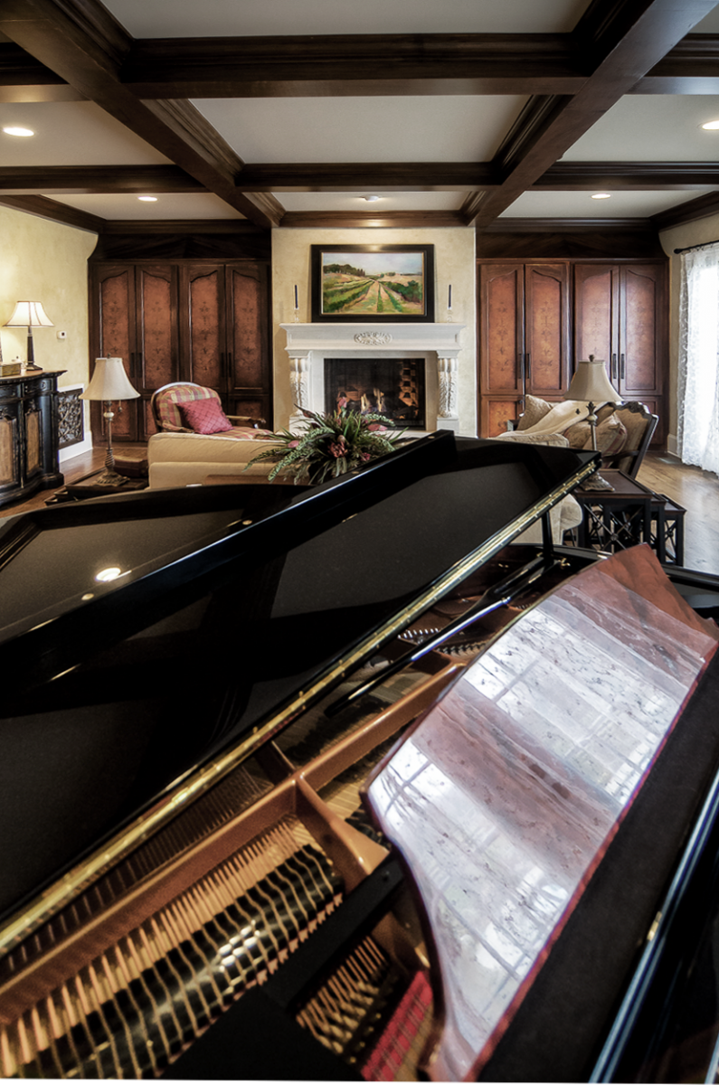 European plaster walls, wood grained coffers with custom hand painted built-in wood graining and mural door faces.
