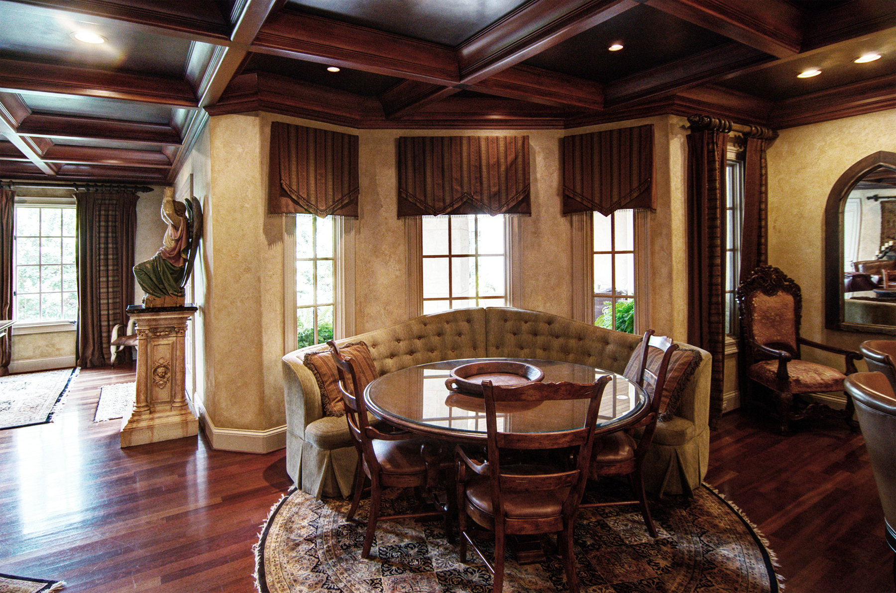 Wood grained coffer ceiling with  faux metal inserts and Tuscan colored plaster walls. Beautiful!