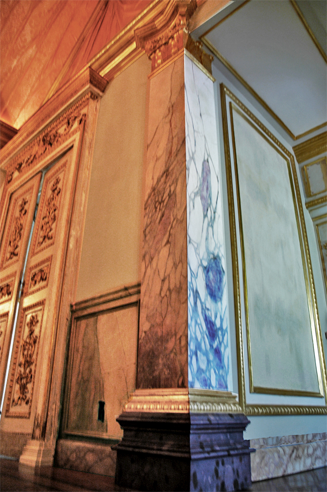 Private Client - Faux Classico marble columns with Russo marble bases, wood grained wainscot, faux wood grained inlay flooring, gold leaf millwork trim and painted folding faux copper ceiling - front side view.