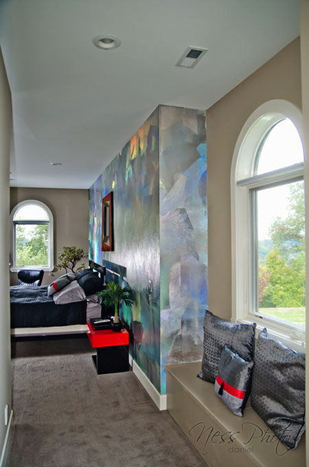 Modern look of holographic foil and ruby red burnished Venetian plaster wall design master bedroom.