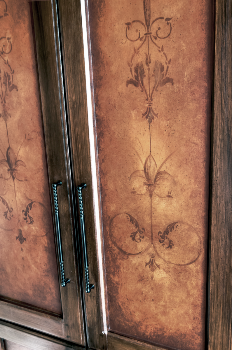 Custom hand painted built-in wood graining and mural door faces. Close-up