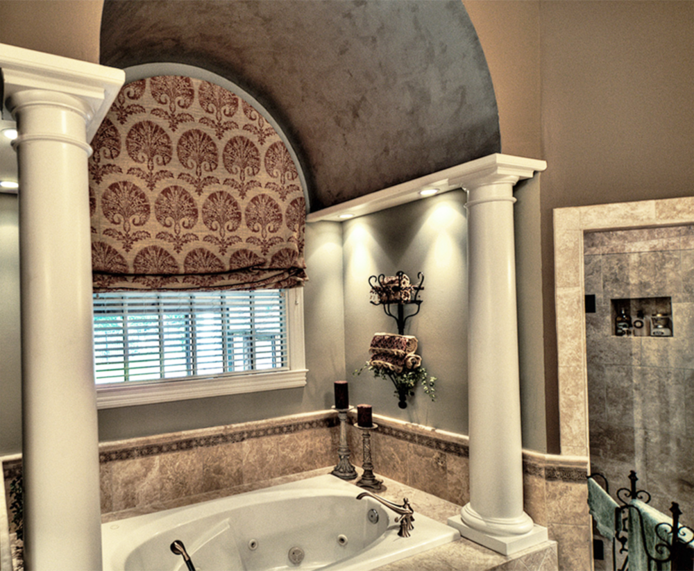 A metallic silver and gold barrel ceiling with accent colored walls make this Franklin, TN customer's master bath the perfect spa retreat.