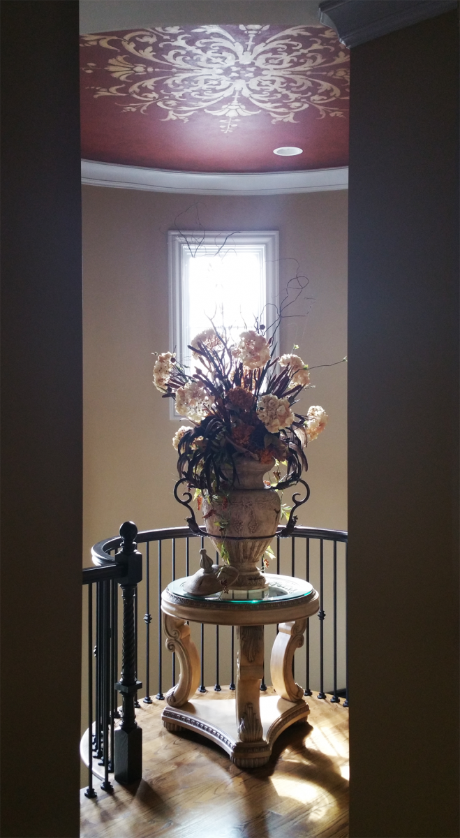 Custom hand painted ceiling stencil with warm toning over glaze